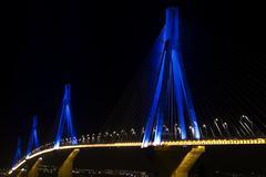 Rio-antirio bridge over sea, illuminated at night. Stock Photos