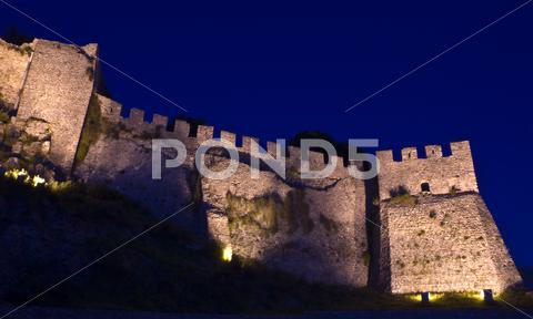 Stock photo of nafpaktos venecian castle illuminated at night.