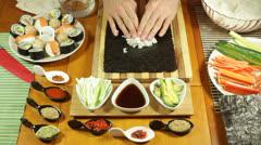 Putting Sushi rice on seaweed Stock Footage