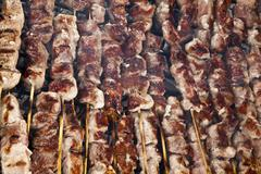Stock Photo of souvlaki grilled on coal