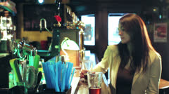 Woman drinks in the pub - dolly Stock Footage