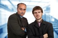 Stock Photo of two young pensive business men portrait standing