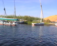 Medium shot of an egyptian gulet with passengers on the Nile Stock Footage
