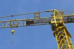 Yellow crane on blue Stock Photos