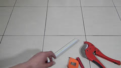 Plumber cutting plastic pipe Stock Footage