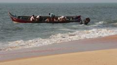 Fishermen unload fresh catch of fish on beach - Kerala India timelapse Stock Footage