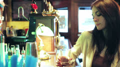 Pensive woman in a pub  - dolly Stock Footage