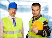 Stock Photo of proud boss and worker standing looking at the camera