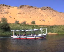 Egyptian gulet cruising on the Nile with sand dunes in background Stock Footage