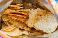 Fried potato chips Stock Photos