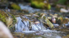 Water flowing over rocks Stock Footage