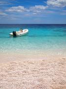 private beach with speedboat - stock photo