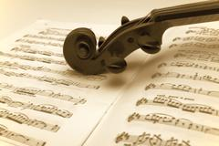 Vintage violin resting on a sheet music Stock Photos
