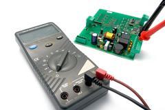 Multimeter and printer circuit board Stock Photos