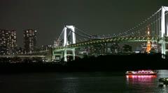 The Rainbow Bridge with pleasure ships, Odaiba, Tokyo, Japan Stock Footage