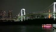 Stock Video Footage of The Rainbow Bridge with pleasure ships, Odaiba, Tokyo, Japan