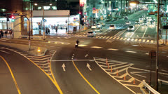 Stock Video Footage of Night intersection of city roads with cars, Tokyo, Japan
