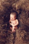 Stock Photo of newborn baby on fur