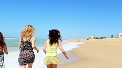 Friends running in the sea Stock Footage