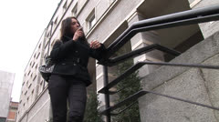 HD1080i Young brunette woman talking on cell phone in the city. Stock Footage