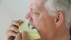 Man eats slice of melon Stock Footage