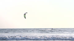 INDIA GOA Arambol beach February 21, 2013. Kiteboarder enjoy surfing in the sea Stock Footage