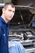 mechanic: trustworthy mechanic by SUV - stock photo