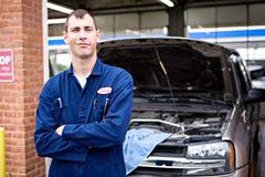 Mechanic: standing by automotive bay Stock Photos