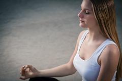 young girl meditating - stock photo