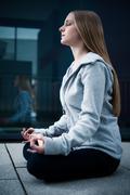 Young girl meditating Stock Photos