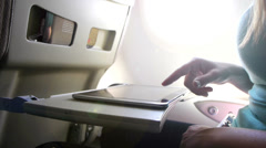 CLOSE UP: Using digital tablet on a plane Stock Footage
