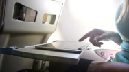 Stock Video Footage of CLOSE UP: Using digital tablet on a plane