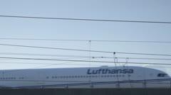 Lufthansa Airbus taxi over bridge - stock footage