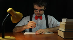 Nerd man counting money at night - stock footage