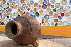 artisan's wall of handpainted plates - stock photo