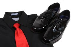 Shiny men's dressy shoes, shirt and tie Stock Photos