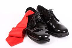 shiny men's dressy shoes and red tie - stock photo