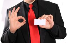 business card and ok sign - stock photo