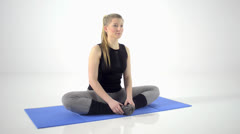 Young girl does a yoga exercise Stock Footage