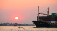 Passing container vessel South East Asia Stock Footage