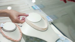 Buying Chinese pearls in store Stock Footage