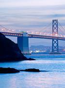 the bay bridge and yerba buena island at dusk - stock photo