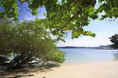 kham island beach with harbour - stock photo