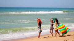 Friends having fun with scarfs on the beach Stock Footage