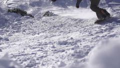SLOW MOTION: Snow spraying under the snowboard - stock footage