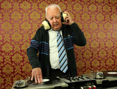 Very funky elderly grandpa dj mixing records Stock Footage
