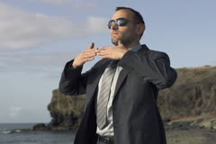 Businessman doing breathing exercises by the sea NTSC Stock Footage
