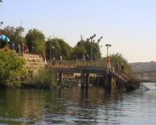 Passengers walking up footbridge onto Philae island Stock Footage