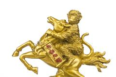 statue monkey riding a horse - stock photo