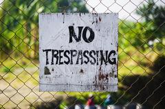no trespassing signage - stock photo